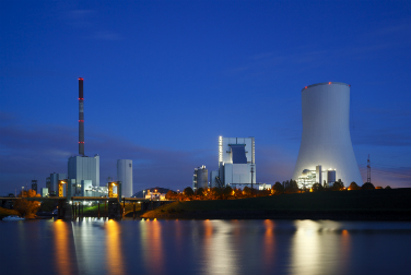 Nuclear power station at night viewed from across the river